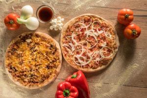 La oferta de Pizzerías Carlos se basa en la recuperación de los sabores de las pizzas que se popularizaron en España en los años 90.